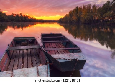 Beautiful sunset with fishing boats on Tisza river