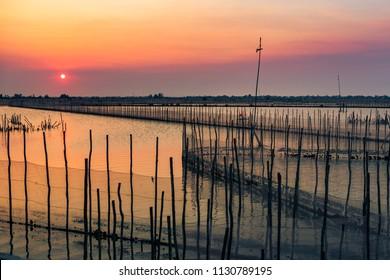 Beautiful sunset in a fishing farm in Vietnam