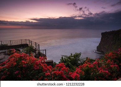 Beautiful sunset with flowers in Bali.