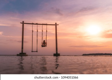 Beautiful sunset in Gili Air with a girl enjoying the romantic mood in the foreground, Indonesia (near Bali, view over Gili Meno)