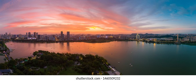 Beautiful sunset glow over Xuanwu Lake in Nanjing city taken with a drone flying in the air.