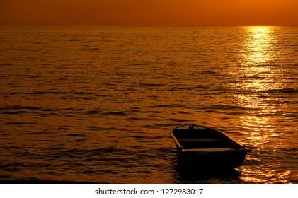 Beautiful sunset golden light with fisherman boat
