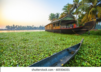 Beautiful sunset with houseboat in the backwaters of Kerala, India