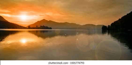 beautiful sunset at lake with mountain range