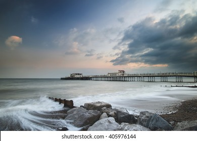 Beautiful sunset landscape image of pier at sea in Worthing England