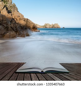 Beautiful sunset landscape image of Porthcurno beach on South Cornwall coast in England coming out of pages in magical story book