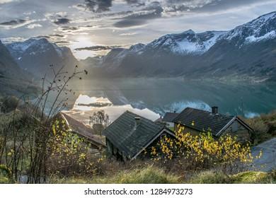 Beautiful sunset in beautiful landscape . Photo from Flo in Oppstryn , in Norway .