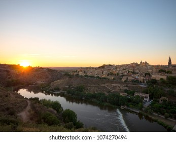 Beautiful sunset landscape of Toledo old town and river Tajo, Spain.