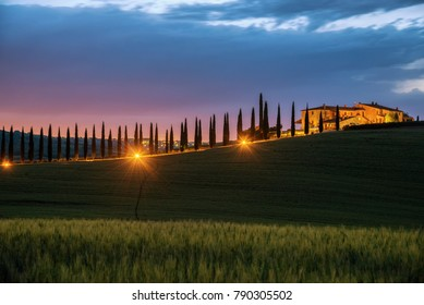 beautiful sunset landscape view of Tuscany view, hills farm and meadow, Toscana - Italy