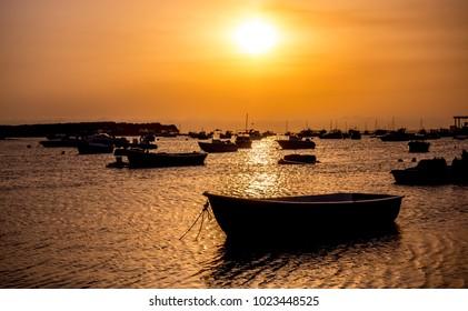 Beautiful sunset landscape whit boat in Porto Cesareo, Salento.