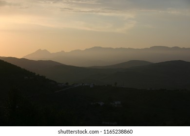 beautiful sunset in layers of gold and brown in spanish countryside