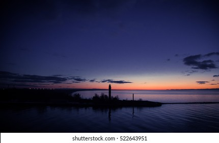 A beautiful sunset with a lighthouse