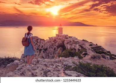 Beautiful sunset in the lighthouse in Melagavi cape at Loutraki, Greece.