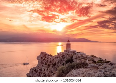 .Beautiful sunset in the lighthouse in Melagavi cape at Loutraki, Greece.