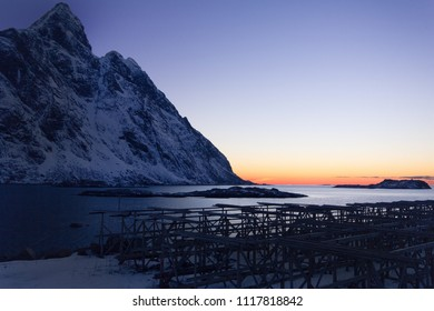 beautiful sunset in Lofoten, Norway, Europe. Stunning mountains, romantic sunset, stockfish, lighthouse in background, calm sea, unique place, nature, travelling, winter, cold, snow.