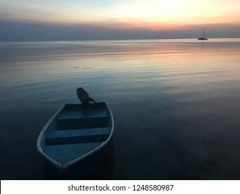Beautiful sunset with a lonely boat in Karimunjawa Island, Central Java Indonesia