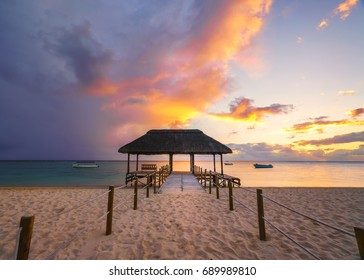 Beautiful sunset in Mauritius Island (flic en flac beach) with Jetty silhouette.