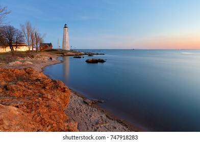 Beautiful sunset of New Haven Light House, Connecticut, USA. The lighthouse is dark, but the tower remains, greeting ships from around the world to New Haven.