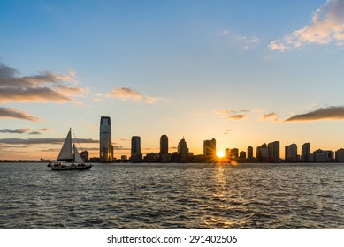 Beautiful sunset with New Jersey skyline from Battery Park, NY