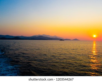 Beautiful sunset in the ocean with yellow, orange and red colors in the sky