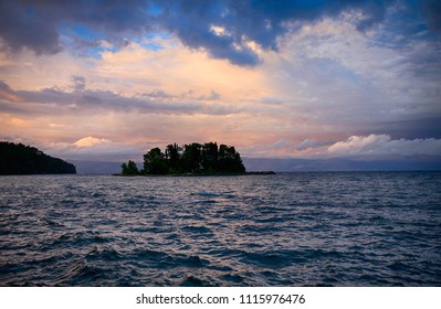A beautiful sunset off the coast of the island of Corfu. Evening seascape