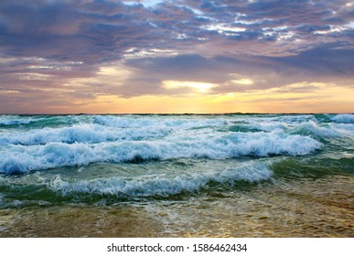 Beautiful sunset on the beach. The surf pounds the shore. Phuket, Thailand