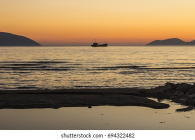 Beautiful sunset on the beach in Vlore (Vlora) Albania. Sunset sky on the beach in Albania