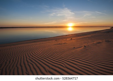 Beautiful sunset on the beach of the Volga river
