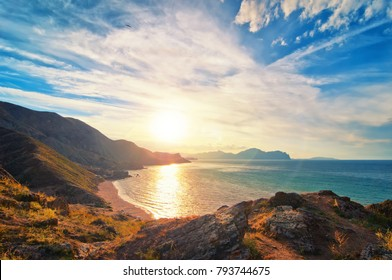 Beautiful sunset on a Black sea coast with mountains and blue sky
