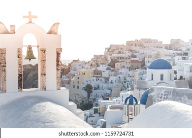 A beautiful sunset on the blue roof of Santorini, Greece