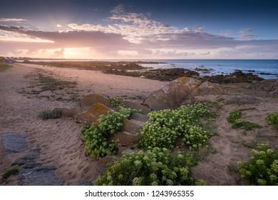 Beautiful sunset on the coast of the Île d'Yeu Island (Yeu Island), Vendee, France Atlantic Ocean.