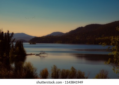 A beautiful sunset on a dreamy lake in the mountains. Dream away with this beautiful and zen scenery.