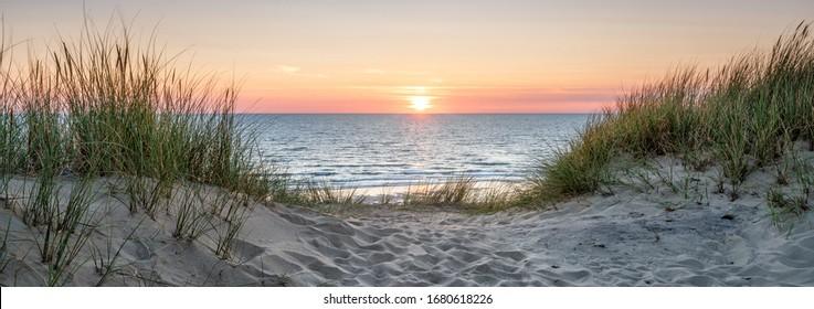 Beautiful sunset on the dune beach, North Sea, Germany