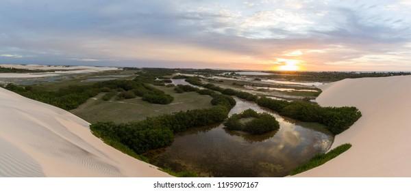 A beautiful sunset on a dune of Tatajuba near Jericoacoara, in Ceara state, Brazil