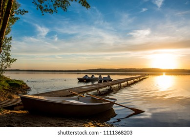 Beautiful sunset on a lake in the background of a boat. Svetna Rasa, Sventa, Daugavpils, Latvia.