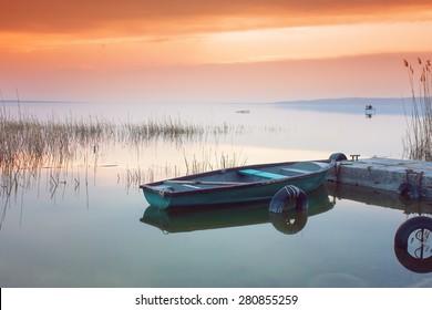 Beautiful sunset on Lake Balaton with anchored boat
