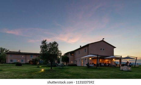 Beautiful sunset on luxury Tuscan resort with outdoor restaurant, Pontedera, Pisa, Tuscany, Italy