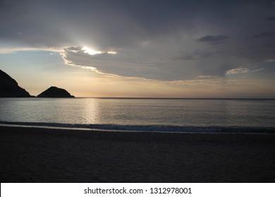 Beautiful sunset on Petani beach on the Kefalonia Island (Ionian Island) in Greece. Natural Landscape. Summer, sea, clouds.