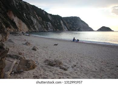 Beautiful sunset on Petani beach on the Kefalonia Island (Ionian Island) in Greece. Natural Landscape. Summer, sea, waves, clouds.