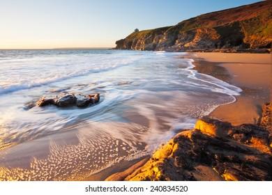 Beautiful sunset on Porthcew beach at Rinsey Cove Cornwall England UK Europe