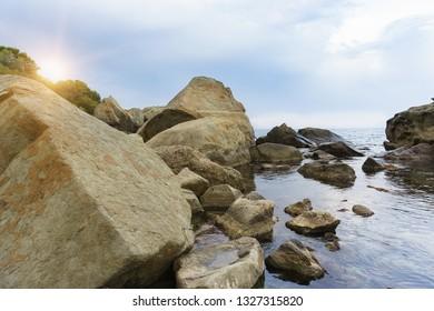 Beautiful sunset on the rocky shore of the Black sea. Crimea, Russia