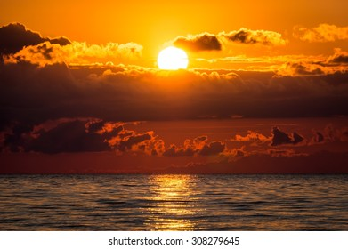 Beautiful sunset on sea with clouds