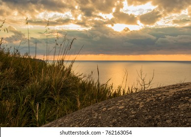 beautiful sunset on seascape. Red, yellow sky with clouds in background. Sunshine on the sea. Italy, Calabria