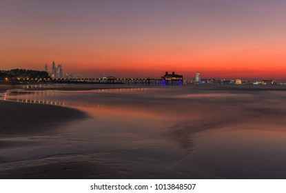 Beautiful sunset on the shore of the Persian Gulf. Dubai. United Arab Emirates.