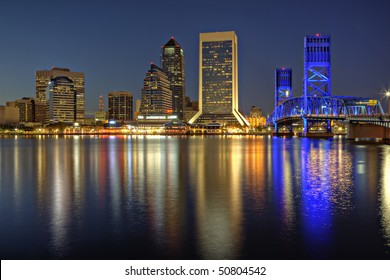 Beautiful sunset on St. John's River and Jacksonville, Florida skyline showing the John T. Alsop Jr. Bridge