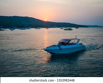 Beautiful sunset on Thailand sea with a white motor boat - background