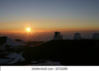 A beautiful sunset on top of Mauna Kea looking at the Observatories on the Big Island of Hawaii