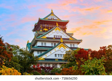 Beautiful Sunset of Osaka Castle in Osaka with autumn leaves landmark of Unesco, Japan.
