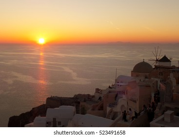 Beautiful Sunset over Aegean Sea at Oia Village, Santorini Island of Greece