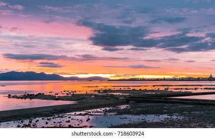 A beautiful  sunset over Ardrossan and Arran with the firey sun reflecting off the water on the bay between Saltcoats and Ardrtossan.